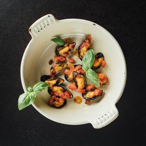 Mosselen in kruidige tomatenboter